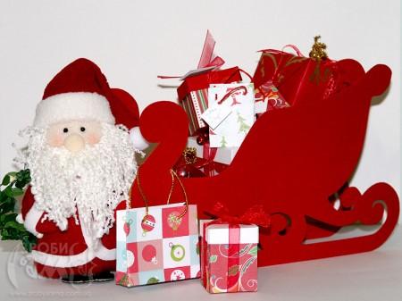 Санта і його сани повні подарунків