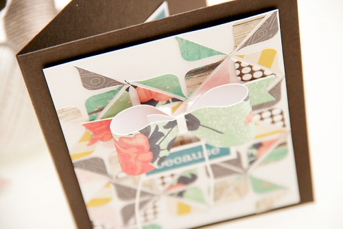 Card a month video series | Bow card + a fun background using only We R Memory Keepers Envelope Punch Board, leftover strips of paper and stamps from Neat & Tangled