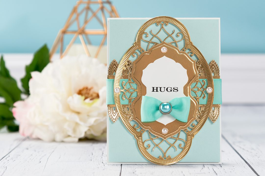 Spellbinders | Chantilly Paper Lace Hugs Card. Project by Yana Smakula using S4-817 Breanna's Corset Label, S4-819 Lilly Pearl Flat Fold Flower/Border, S5-329 Hannah Elise Layering Frame Small dies. #cardmaking #spellbinders #diecutting